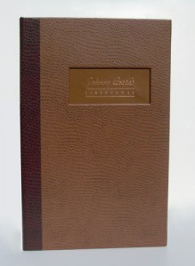 custom menu cover in Ostrich with copper inset within window